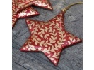red gold swirl star.jpg 1